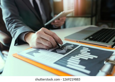 Businessman working with virtual interface icons.