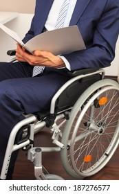 Businessman working in a wheelchair