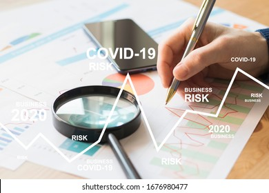 Businessman works with documents a business risk chart due to a coronovirus pandemic. Business risks covid-19
