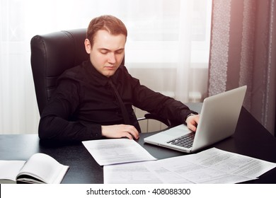 Businessman works with documents and papers at workplace