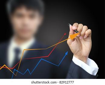 Businessman write graph