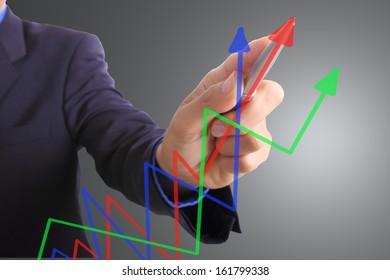 Businessman write graph business for explain something
