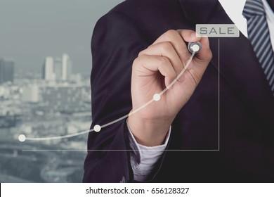 Businessman write line graph for presentation the business success, goal, sale achievement