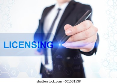 Businessman Write On The Virtual Screen Licensing. Close Up Hand With A Pen. Touch Screen. Virtual Icon. Graphs Interface. Business concept. Internet concept. Digital Interfaces
