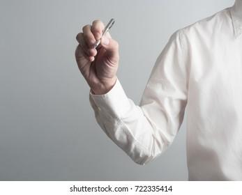 Businessman write something .Idea business on white