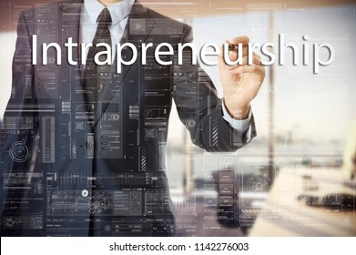 businessman writes a popular buzzword on a virtual whiteboard: Intrapreneurship
