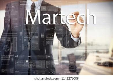 businessman writes a popular buzzword on a virtual whiteboard: Martech
