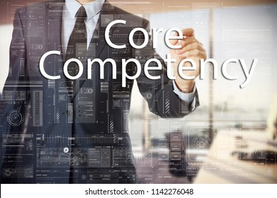 businessman writes a popular buzzword on a virtual whiteboard: Core Compotency