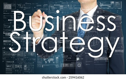 the businessman is writing Business Strategy on the transparent board with some diagrams and infocharts with the dark elegant background