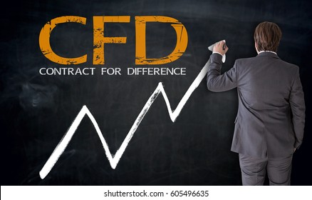 Businessman writing CFD on blackboard concept.