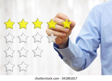 businessman writing  five star rating