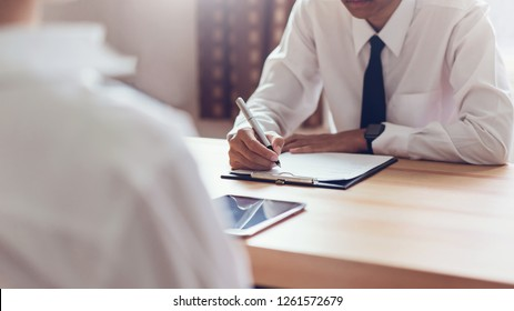 Businessman writing form submit resume employer to review job application. Concept presents ability for the company to agree with position of job.