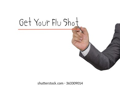 Businessman writing Get Your Flu Shot with pen on visual screen. Business, technology, internet concept.