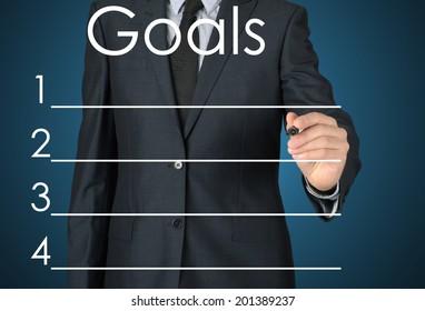 businessman writing goals