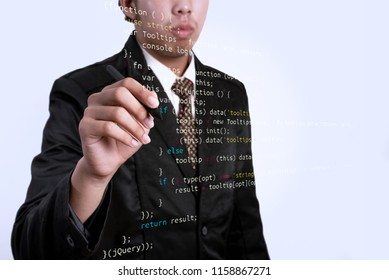 Businessman writing jQuery with marker on transparent board. Business, internet, technologyconcept.
