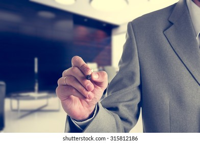 businessman writing with a marker on the virtual display in the office. your text.