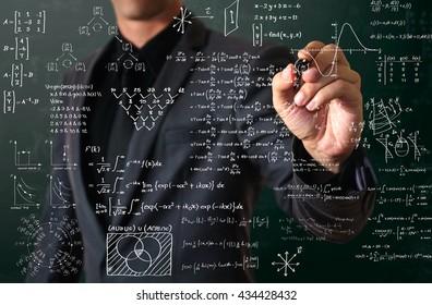 businessman writing mathematical formula