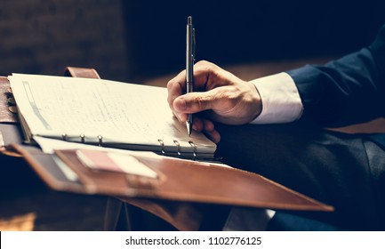 A businessman writing a note