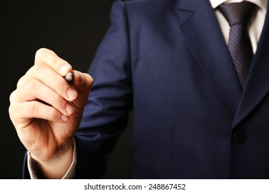 Businessman writing on screen, close-up