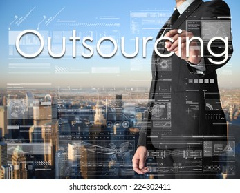 businessman writing  on transparent board with city in background