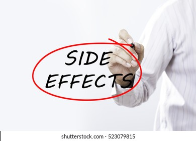 "Businessman writing ""SIDE EFFECTS"" with marker on transparent board.  Medical concept"