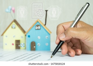 Businessman writing signature in documents agreement contract for family and buy new house or property investment project with minimal home. Investment mortgage agent marketing in real estate concept.