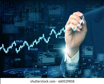businessman writing stock graph