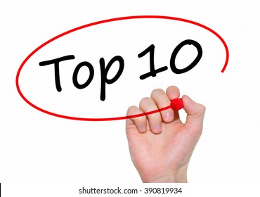 Businessman writing Top 10 with marker on transparent board. Business, internet, technology concept.