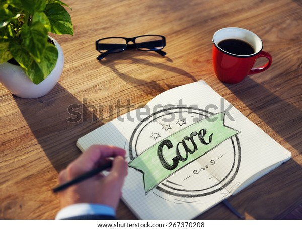 """Businessman Writing the Word """"Care"""""""