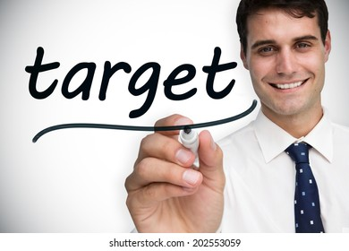 Businessman writing the word target against white background with vignette