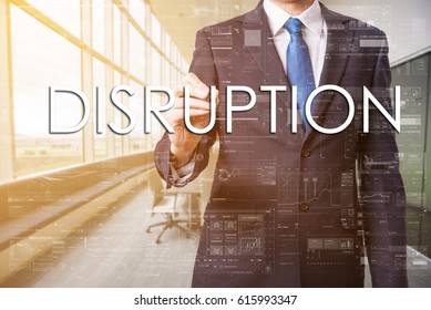 Businessman wrote Disruption on transparent board in office. Business text concept.