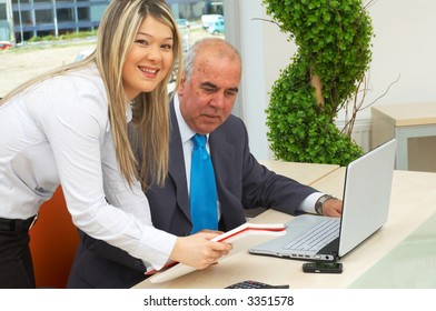 businessman and young businesswoman working on a modern laptop