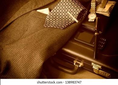 Businessman's accessories. Sepia image.