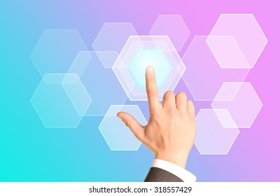 Businessmans arm clicking on virtual colorful screen