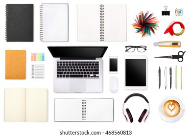 Businessman's desk with laptop, tablet smartphone and office supplies on white background