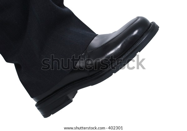 Businessman's Foot ready to step down.