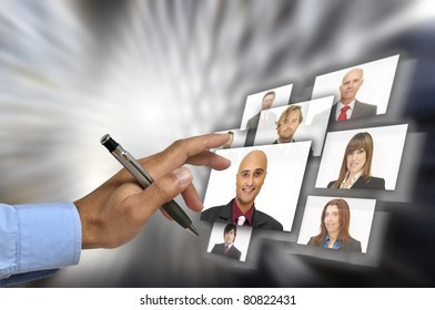 Businessman's hand choosing employees with modern technology