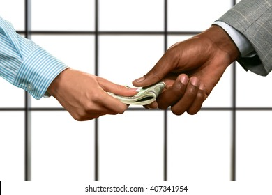 Businessman's hand gives woman dollars. Hands passing american currency. Right investment to make. Money is the best motivation.