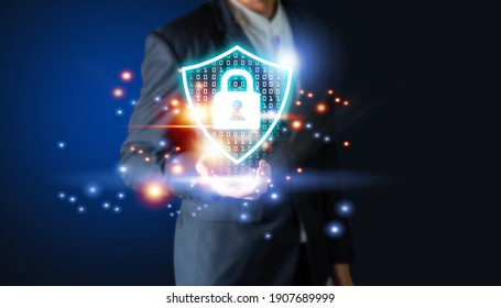 Businessman's hand holding virtual screen padlock and cloud computing global network cyber security data protection business technology privacy concept, Protection internet and clouds business.