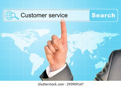 Businessmans hand on abstract blue background with words customer service in browser and world map