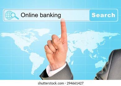 Businessmans hand on abstract blue background with words online banking in browser and world map
