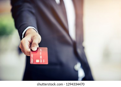 Businessman's hand showing is credit card