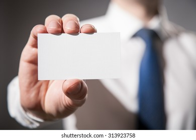 Businessman's hand showing visiting card - closeup shot