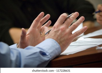 Businessman's hands during meeting
