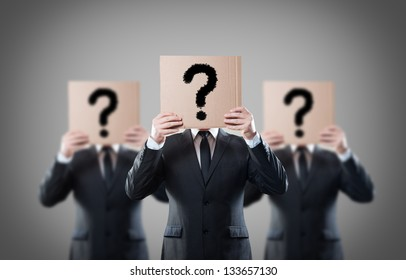 Businessman's holding a card with question