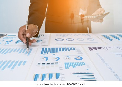 Businessman's key research and audit income statement data from spreadsheets. audit making database report financial planning report in office .research business concept
