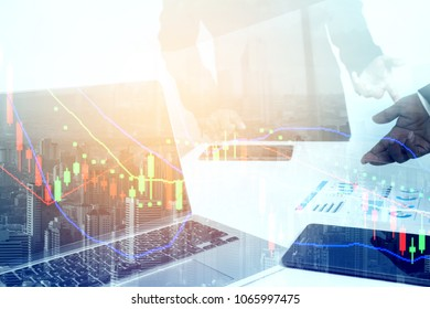 Businessman's key research and audit income statement data from spreadsheets. audit making database report financial planning report and stock market exchange.Investment Analysis concept