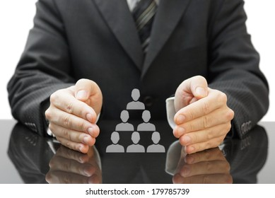 businessman's protecting  employees in his company. concept of employee and business care