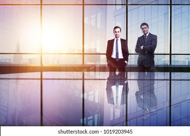 Businessmen in abstract office interior with city view. Teamwork and future concept. Double exposure