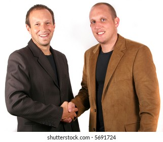 Businessmen Agreeing Two you businessmen shaking hands. Isolated studio shot!